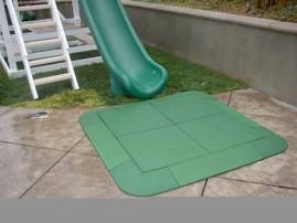 rubber tiles in front of slide